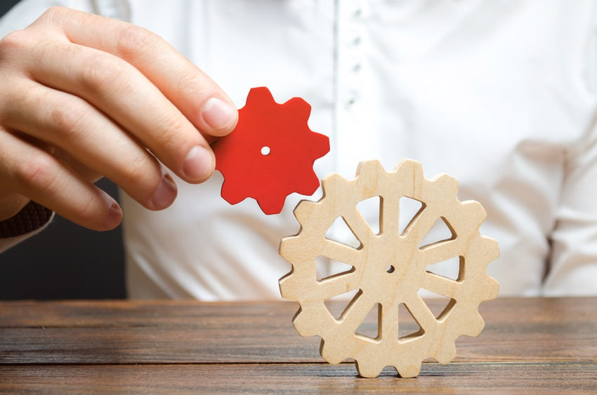 Businessman Connects A Small Red Gear To A Large Gear Wheel Symbolism Of Establishing Business Processes And Communication Increase Efficiency And Productivity The Best Business Formula For Success