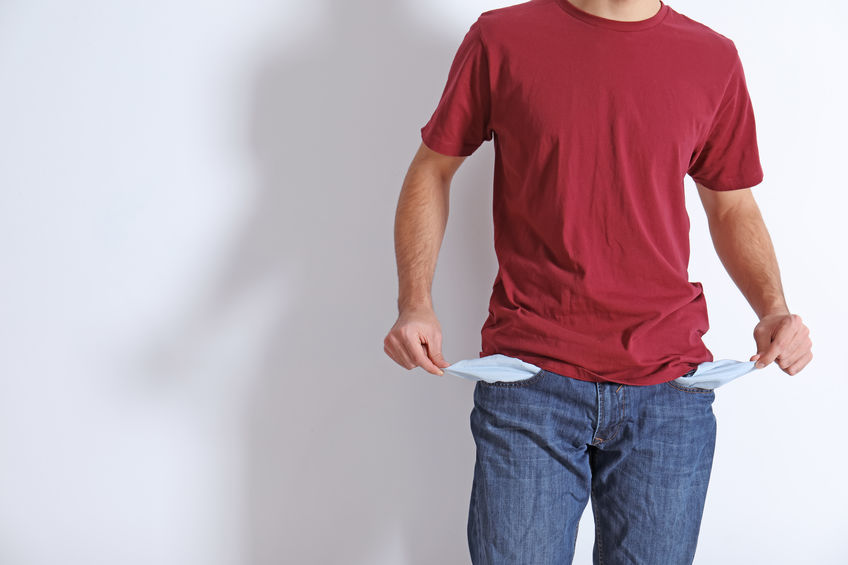 Man Showing Empty Pockets On Light Background Closeup Space For Text